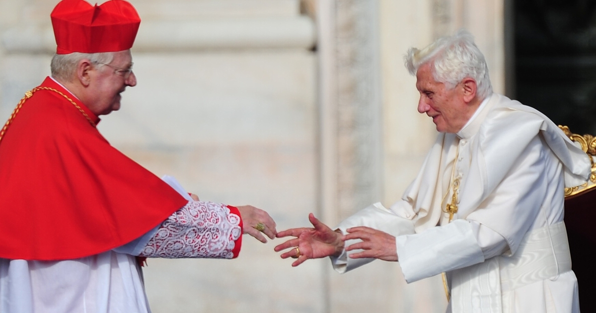 Pope Benedict XVI (R) is greeted by the archbishop of Milan, Cardinal Angelo Scola during a meeting with pilgrims in front of Milan's cathedral, the Duomo, on June 1, 2012. Scola is widely seen as one of the top contenders to succeed Benedict.</p>