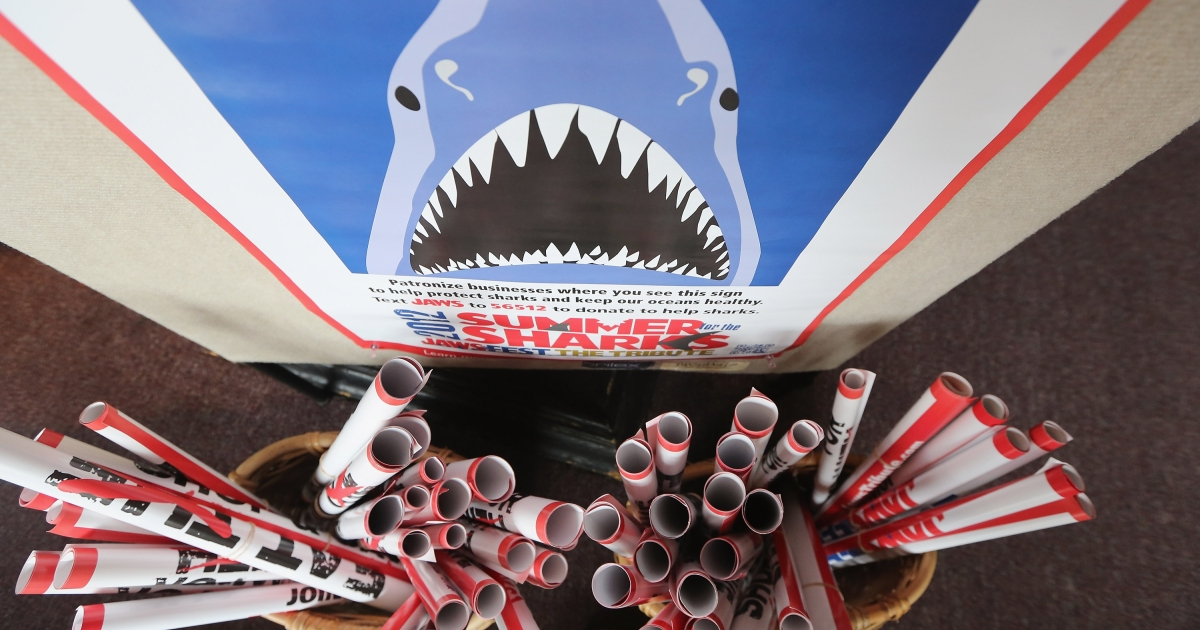 Posters are seen during JawsFest: The Tribute, a festival celebrating the film Jaws, on the island of Martha's Vineyard on August 11, 2012 in Oak Bluffs, Massachusetts.</p>