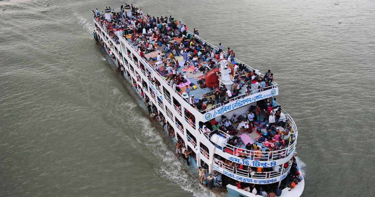 Thousands of Bangladeshis cram ferries, as they rush home to be with their families in remote villages before the Muslim Eid festival, at Sadarghat ferry terminal on the outskirts of Dhaka on August 16, 2012.</p>