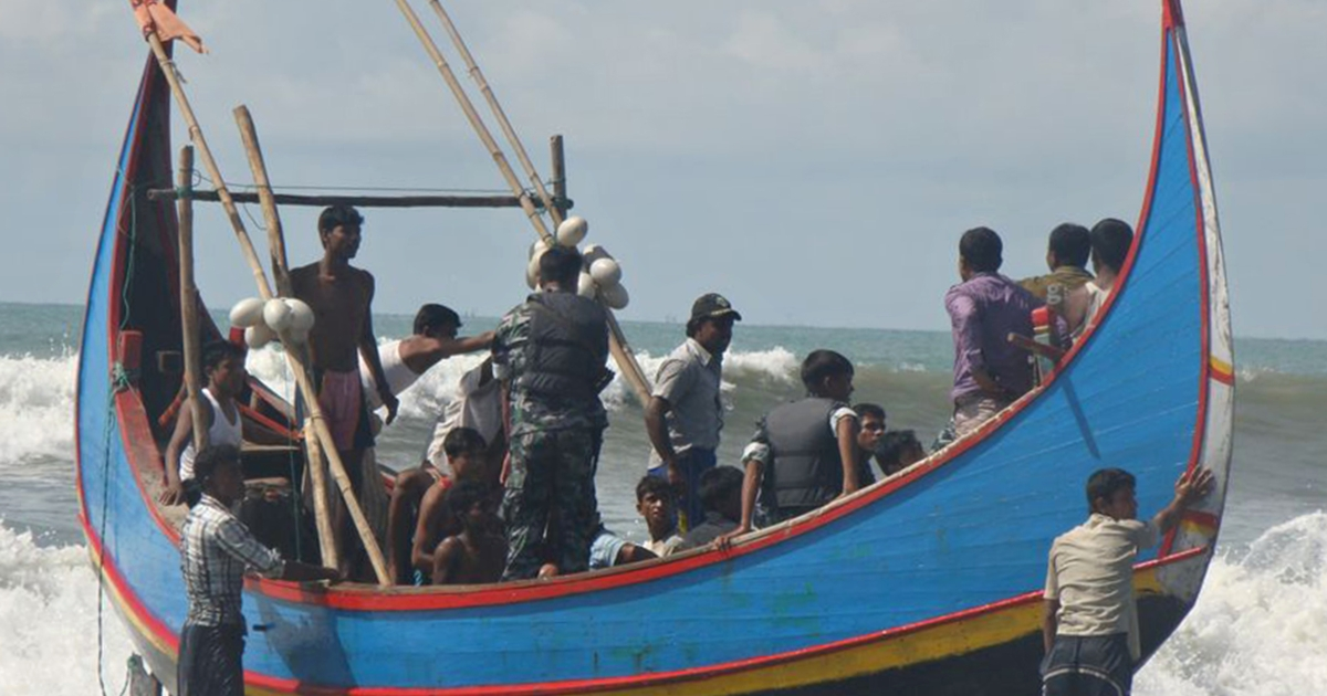 Rohingya refugees, who survived after their overloaded boat heading to Malaysia sank, are pictured on a fishing boat following their rescue by Bangladeshi border guards in Teknaf on November 7, 2012.</p>