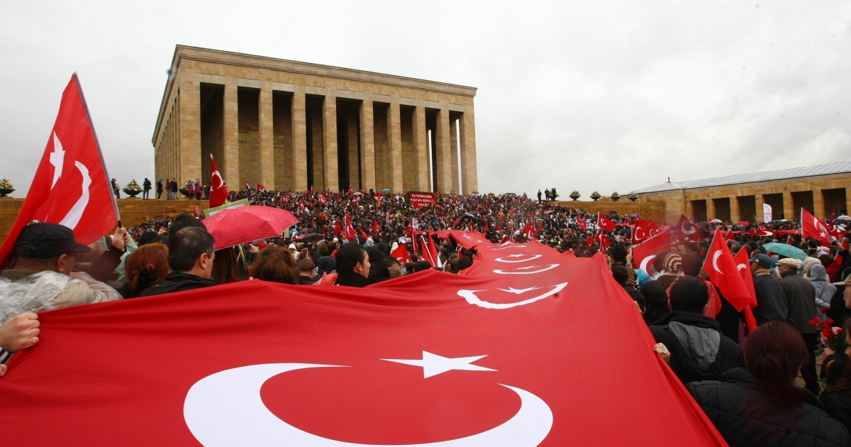 People carry a giant Turkish flag as they gather at the mausoleum of Turkey's founder Mustafa Kemal Ataturk during a ceremony marking the 74th anniversary of his death in Ankara.</p>