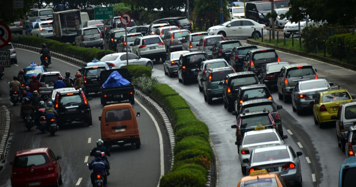 Traffic struggles along a main road in Indonesia.</p>