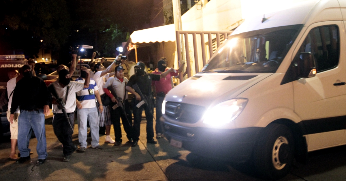 Statal police escort a van with twelve Spanish citizens and a Mexican woman leaving the Office of Justice of Guerrero State in Acapulco on February 4, 2013. Acapulco's mayor Luis Walton confirmed that six Spanish women, part of a group of 13 tourists, were raped by a band of criminals near the touristic port of Acapulco.</p>