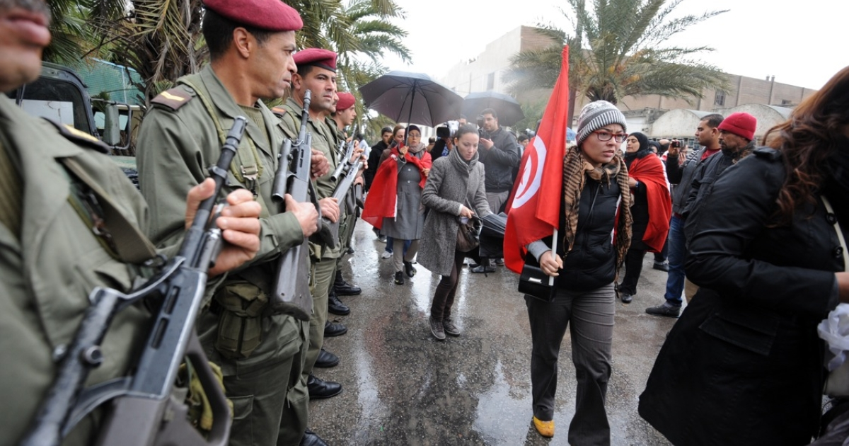 Tunisian soldiers stand guard during opposition leader Chokri Belaid's funeral procession through the capital. At least eight soldiers were killed on July 29, 2013 during a mountain ambush, just five days after another Tunisian opposition leader, Mohamed Brahmi, was shot dead in front of his house.</p>