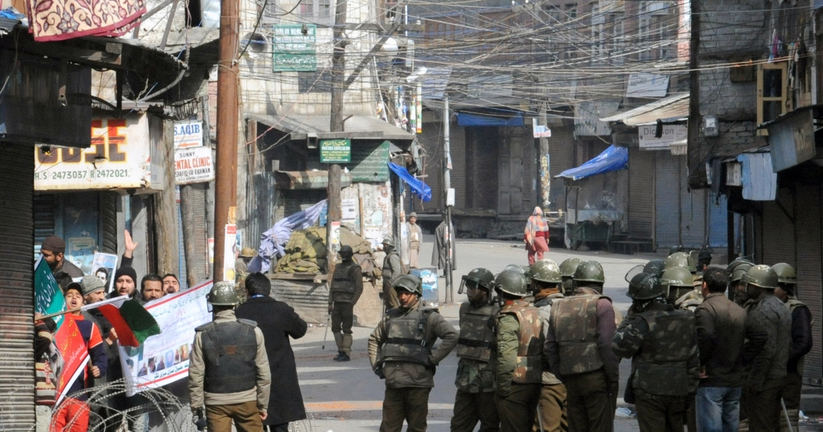 Activists defy a curfew in Kashmir Valley on Feb. 11, 2013.</p>