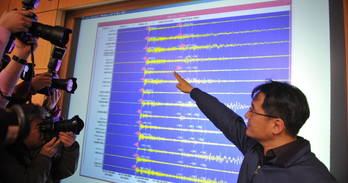 An official of the Korea Meteorological Administration shows a seismic image of a tremor caused by North Korea's nuclear test, in Seoul on February 12, 2013. North Korea staged its most powerful nuclear test yet, claiming a breakthrough with a 'miniaturised' device in a striking act of defiance to global powers including its sole patron China.</p>
