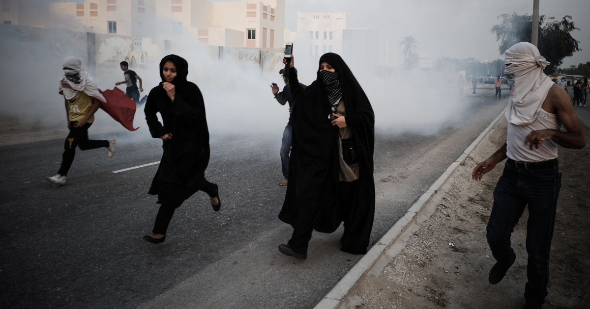 Bahraini protestors run for cover from tear gas fired by riot police following an anti-government rally to demand political reforms on February 12, 2013 in the village of Sanabis, west of the Bahraini capital Manama. Bahrain's opposition groups, expecting little from a renewed national dialogue, plan to stage protests this week to mark the second anniversary of a Shiite-led uprising that was crushed by security forces.</p>