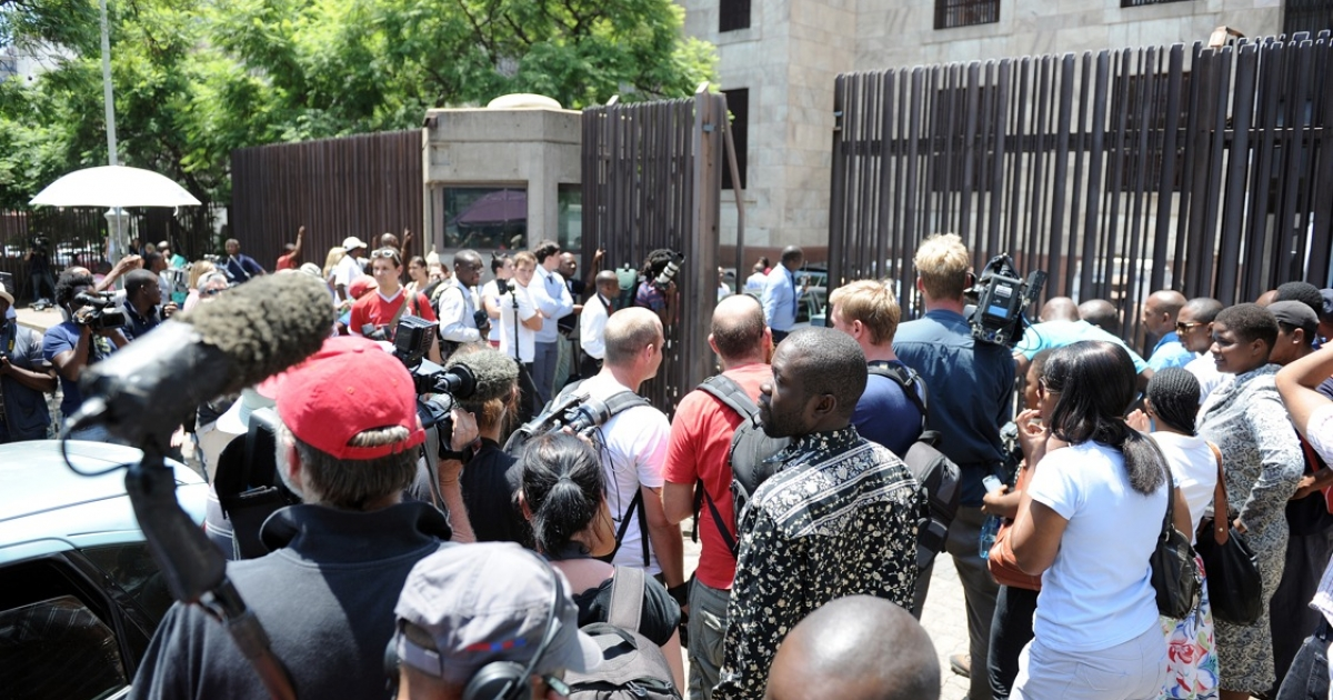A throng of reporters wait outside the Pretoria Magistrate's Court during Oscar Pistorius's first court appearance, Feb. 15, 2013.</p>