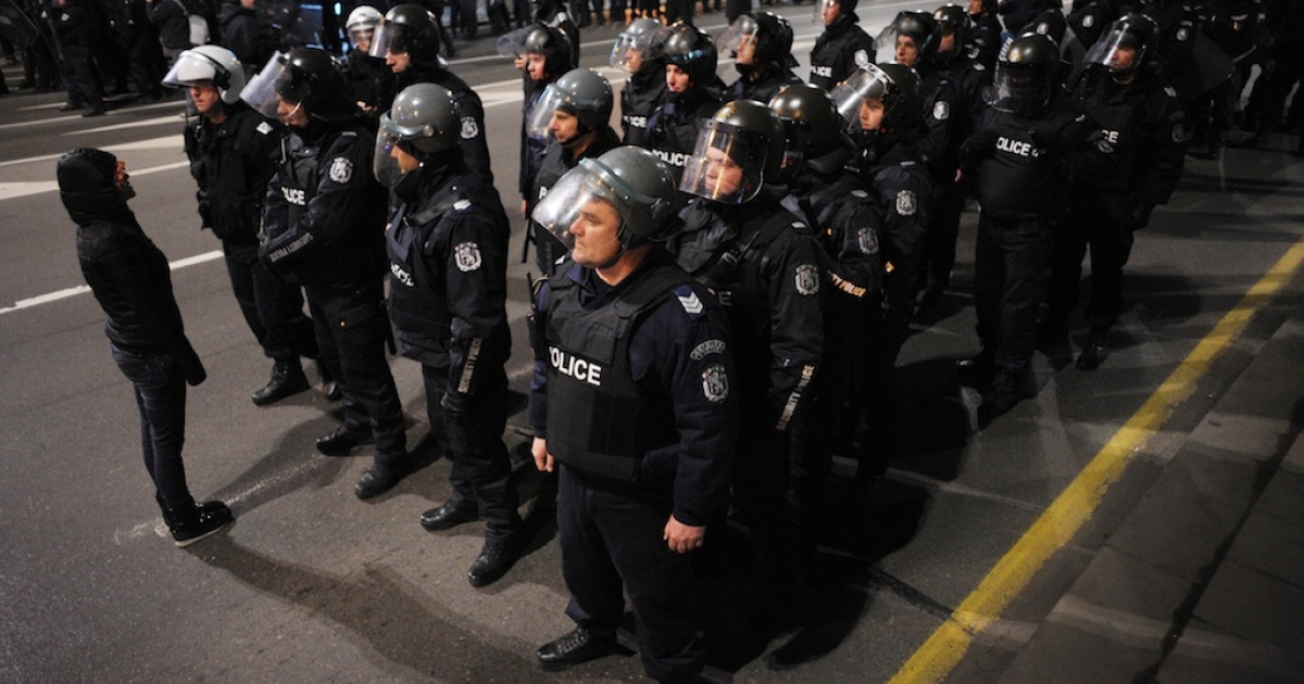 A demonstrator shouts at riot police on February 18, 2013 during a protest in front of Bulgarian Parliament in Sofia.</p>