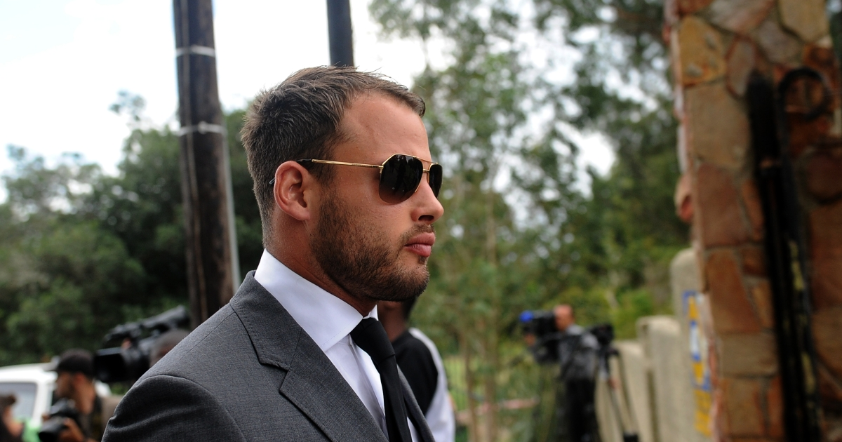 South African Springbok rugby player Francois Hougaard attends a memorial for South African model Reeva Steenkamp in Port Elizabeth on February 19, 2013. Steenkamp, 29, was shot four times in the early hours of February 14, 2013 by a 9mm pistol owned by South African sporting hero Oscar Pistorius.</p>