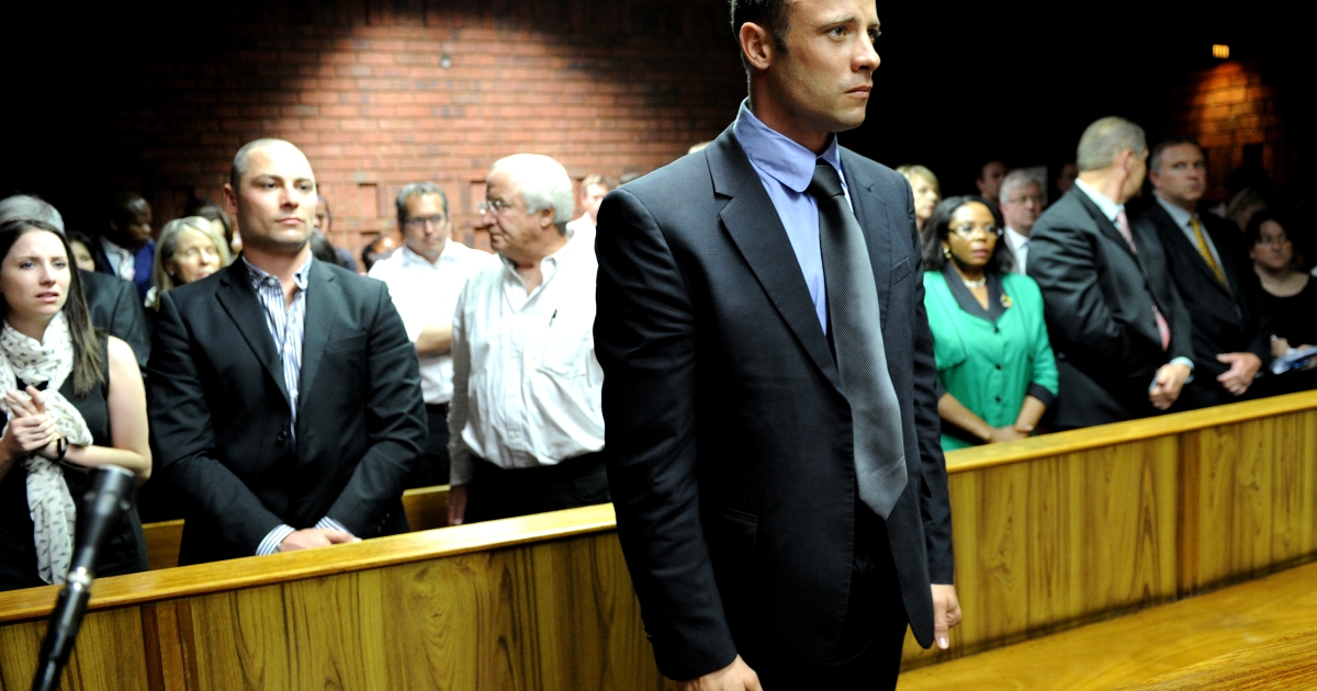 South African Olympic sprinter Oscar Pistorius (C) appears on February 19, 2013 at the Magistrate Court in Pretoria. Pistorius had the terms of his bail relaxed at a hearing on March 28, 2013, though he did not attend.</p>
