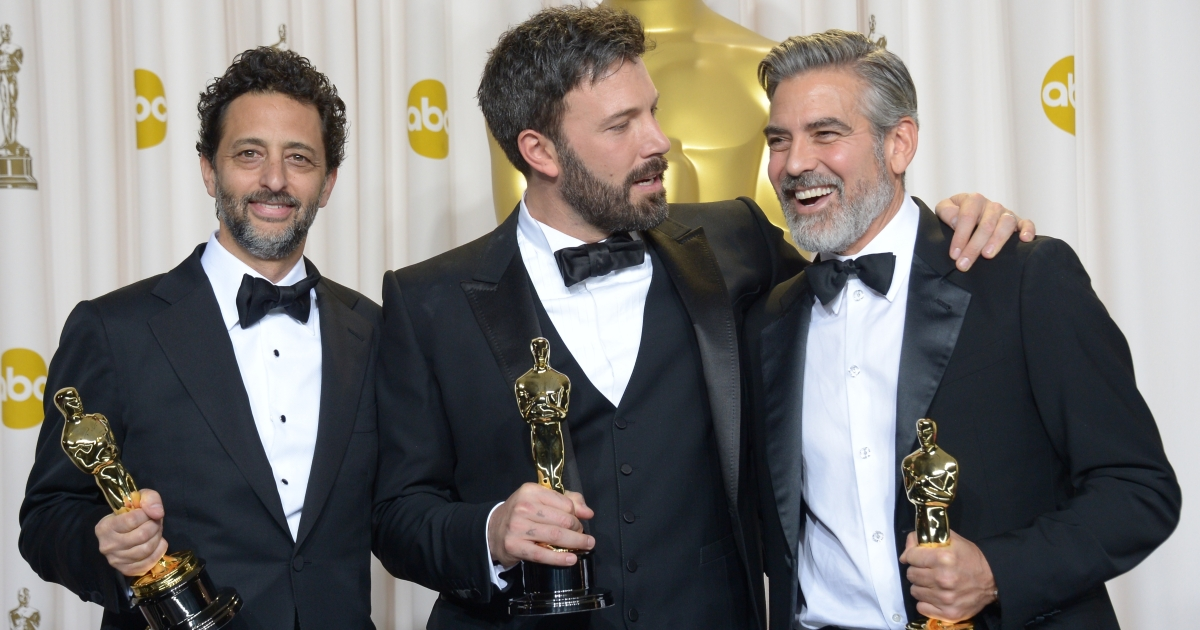 Ben Affleck (C), George Clooney (R) and Grant Heslov celebrate in the press room after winning the trophy for Best Picture for 'Argo' during the 85th Annual Academy Awards on February 24, 2013 in Hollywood, California.</p>