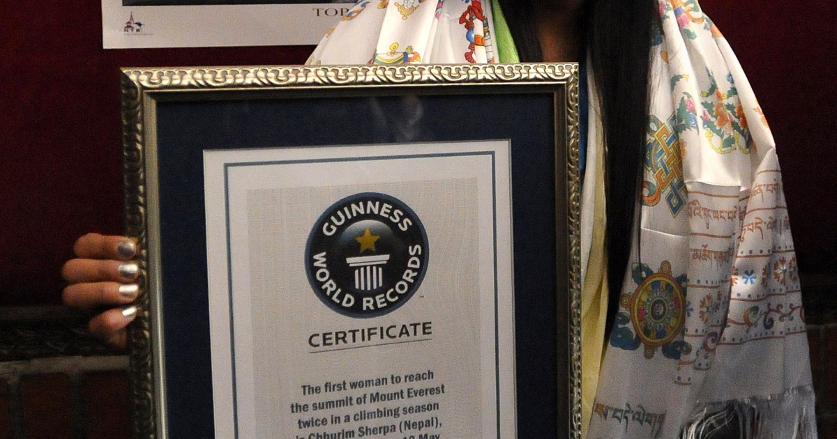 Nepalese climber Chhurim Sherpa, who holds the world record for women summiting Mount Everest twice in one climbing season on May 12, 2012 and May 19, 2012, poses with her Guinness World Record certificate in Kathmandu on February 25, 2013. A Nepalese was the first woman to climb Everest twice in a season, Guinness World Records confirmed Monday, scaling the world's highest mountain within a week.</p>