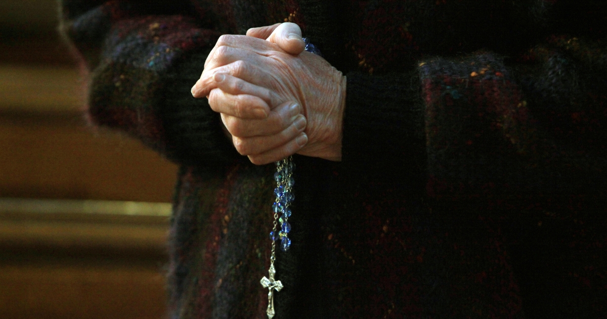 A churchgoer holds a cross and rosary beads in St. Patrick's Cathedral on March 20, 2010 in Armagh, Northern Ireland as the head of the Catholic Church in Ireland, Cardinal Sean Brady, speaks. Brady voiced hope on March 20 that the pope's letter addressing sex abuse by priests could lead to