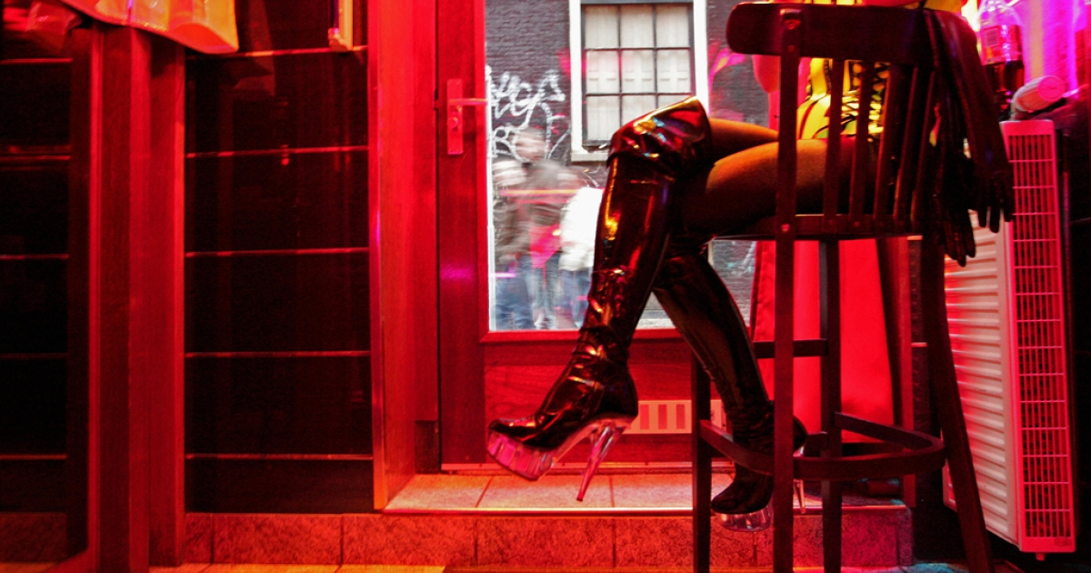A German prostitute, called Eve, waits for clients behind her window in the red light district of Amsterdam. The city announced on February 26, 2013 that it will raise the legal age for prostitutes from 18 to 21.</p>