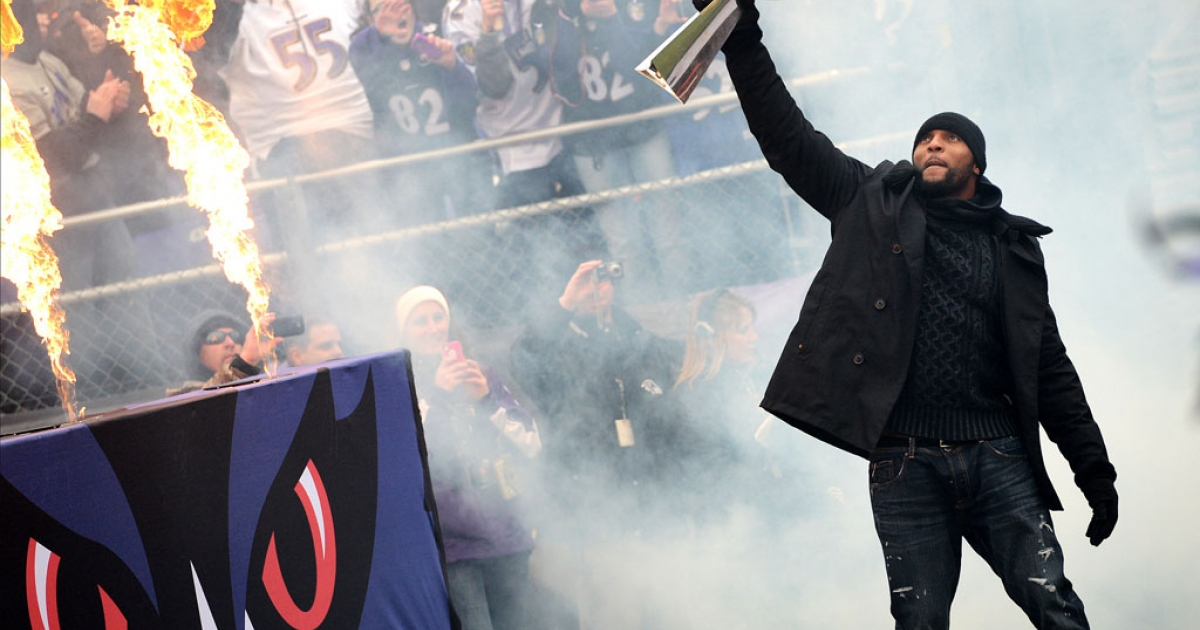 Baltimore Ravens linebacker Ray Lewis enters M&amp;T Bank Stadium with the Vince Lombardi Trophy during the team's Super Bowl parade on February 5, 2013, in Baltimore, Maryland. The Ravens captured their second Super Bowl by defeating the San Francisco 49ers on Sunday in New Orleans.</p>