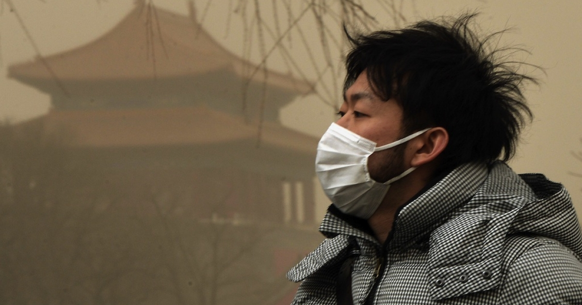 A Chinese man wears a facemask as Beijing is hit by a sandstorm as well as air quality worse than the highest classification of 'hazardous' on February 28, 2013.</p>