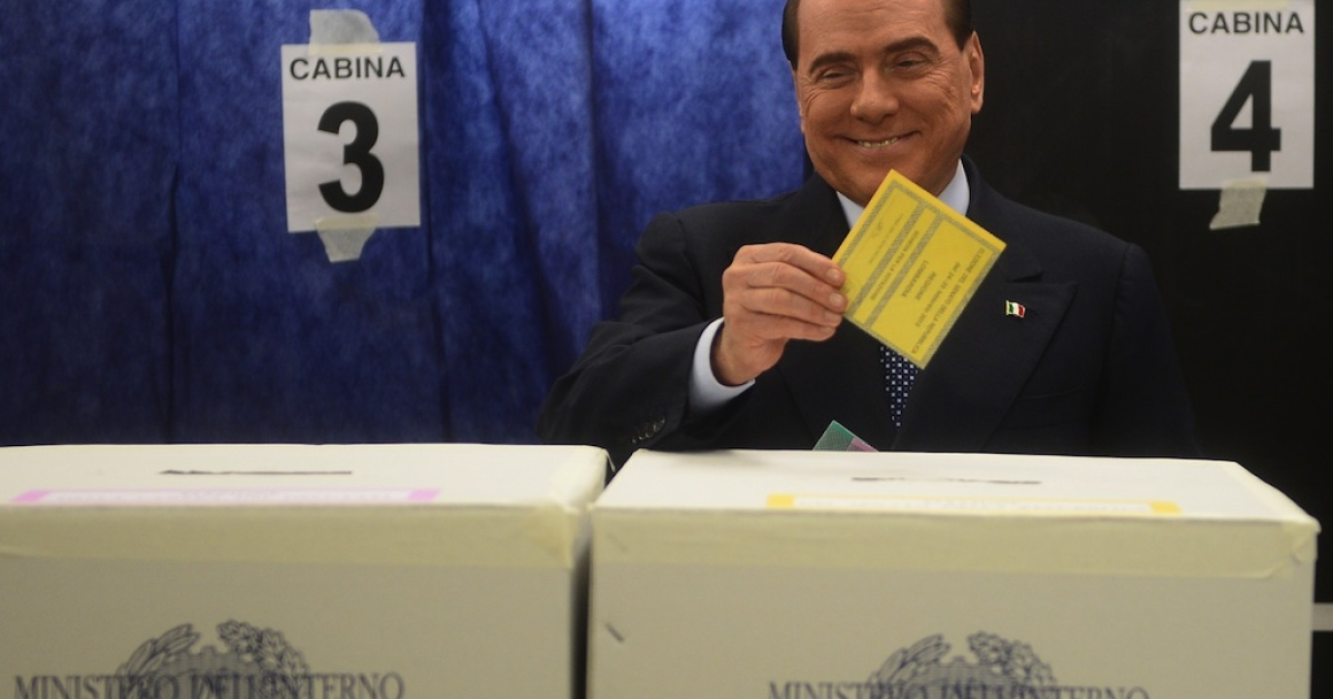 Italian former Prime Minister Silvio Berlusconi casts his ballot at a polling station on February 24, 2013 in Milan. Italians fed up with austerity went to the polls on Sunday in elections where the centre-left is the favourite, as Europe held its breath for signs of fresh instability in the eurozone's third largest economy.</p>
