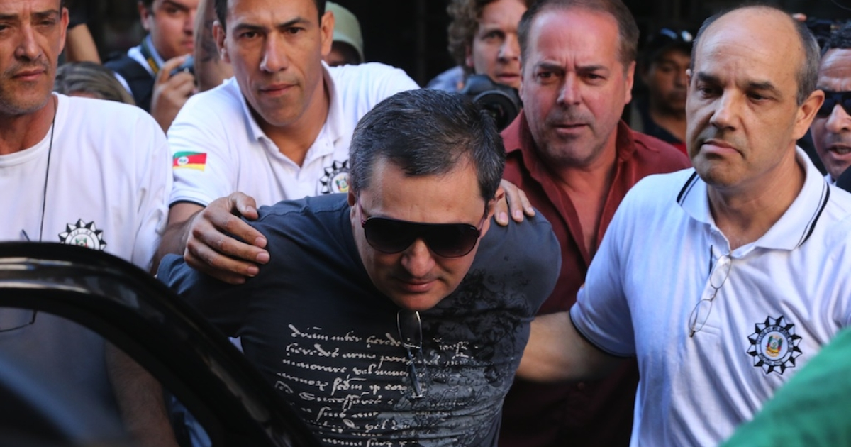 Mauro Hoffman, co-owner of the Kiss nightclub where a blaze on Sunday early morning left a death toll of over 230, is taken into custody by police in Santa Maria, southern Brazil, on January 28, 2013.</p>