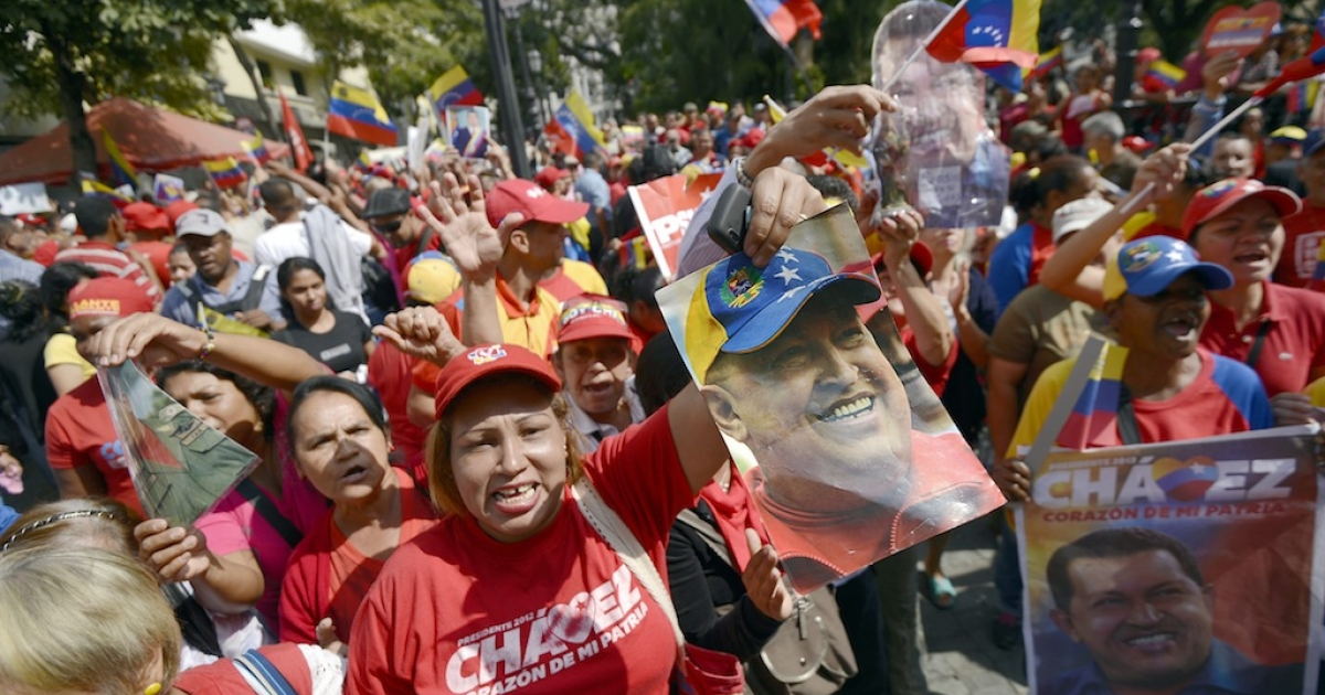 Supporters of Chavez gather at Simon Bolivar Square in Caracas to celebrate their president's return on Feb. 18, 2013.</p>
