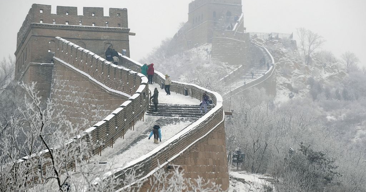 People make their way along the Great Wall of China following a night of snowfall.</p>