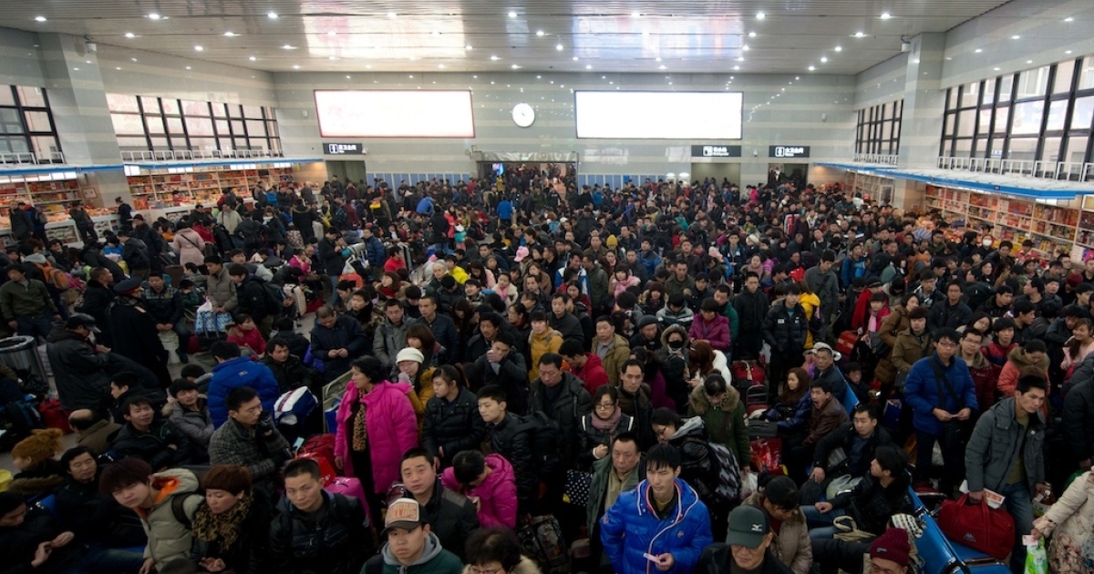 Chinese New Year travellers wait for their train at Beijing West Railway Station on January 31.</p>