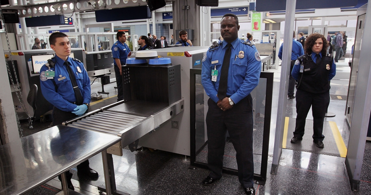 Transportation Security Administration (TSA) officers staff a checkpoint at O'Hare International Airport on March 15, 2010, in Chicago, Ill. Clear, a company that makes it possible for you to save time as you check in, is now supported at Orlando International, Denver International, San Francisco International, Dallas/Fort Worth International and Westchester Airport.</p>