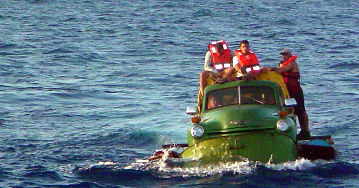 Cuban migrants trying to reach the US coast in Florida ride a makeshift boat made out of a 1951 Chevrolet truck, July 16, 2003.</p>