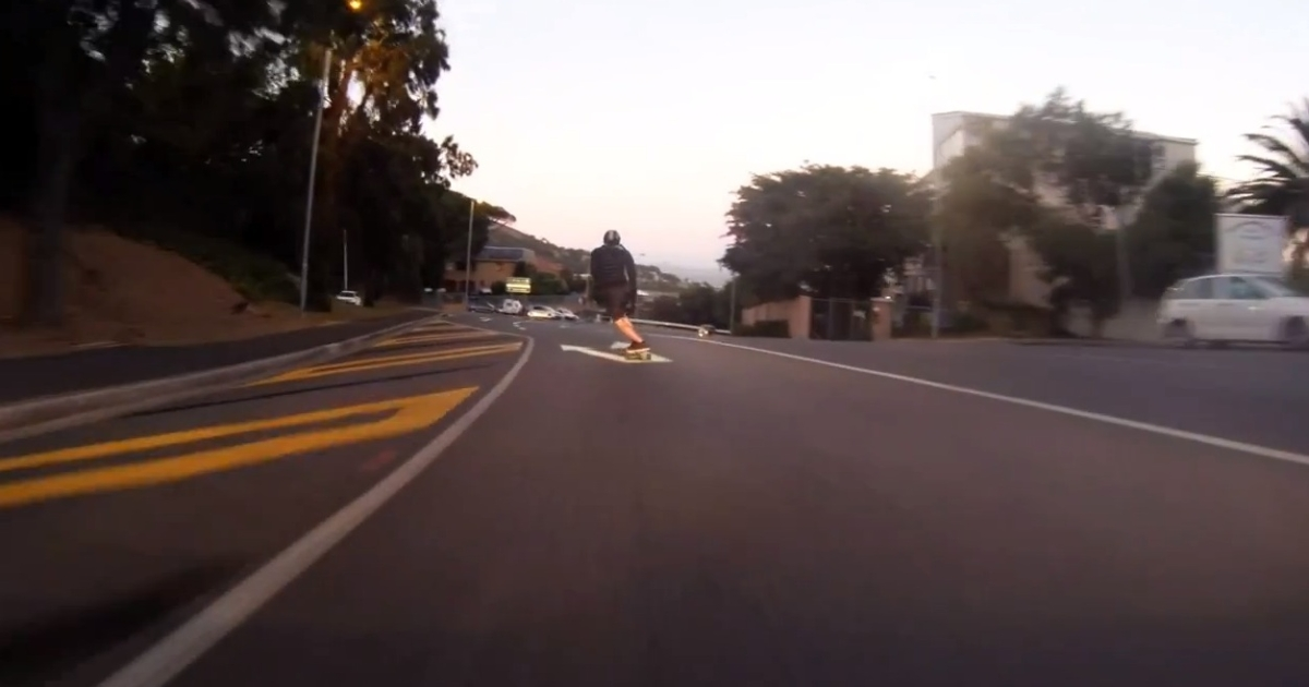 Decio Lourenco skateboarding down Kloof Nek road in Cape Town, South Africa, on Jan. 20, 2013.</p>