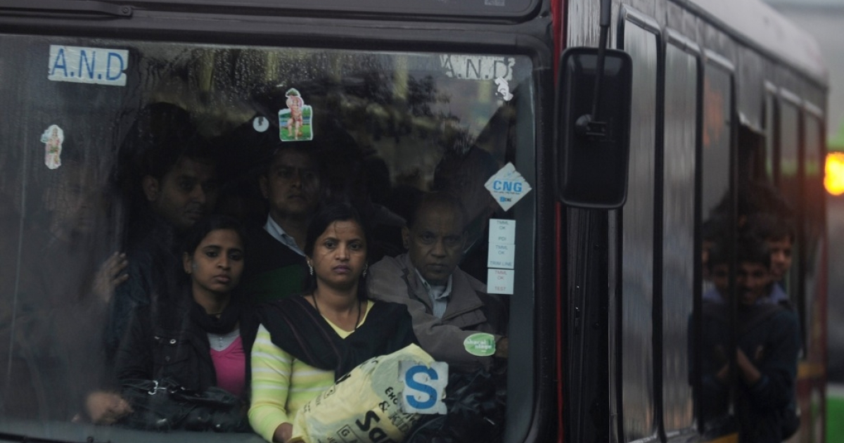 Indian women travel in a bus in New Delhi on February 5, 2013. Five men are on trial for allegedly raping and beating a young woman aboard a bus in December.</p>