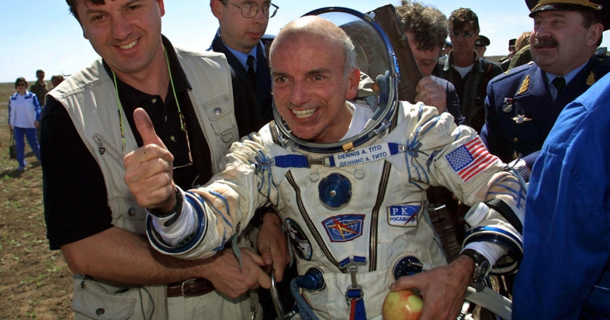 American Dennis Tito celebrates after landing near the Kazakhstan town of Arkalyk on May 6, 2001. The world's first space tourist hailed the trip after the US millionaire and two Russian cosmonauts landed on Earth.</p>