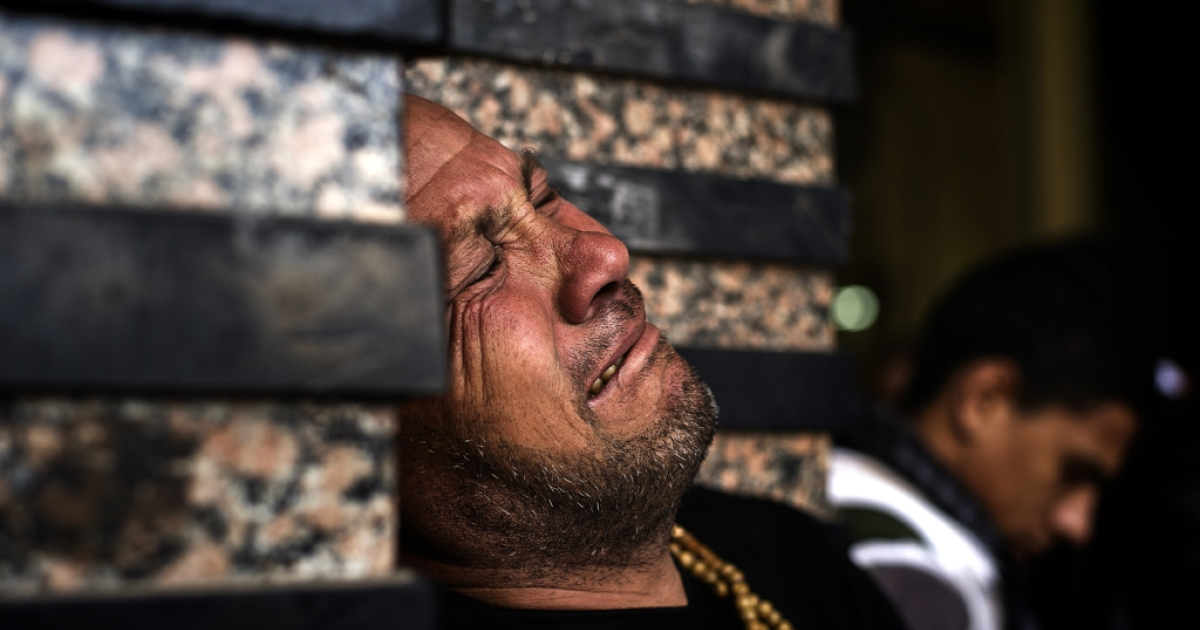 An Egyptian man at the funeral of killed Egyptian activists Amro Saad and Mohammed Al Guindy outside Omar Makram Mosque in Cairo's Tahrir Square, on Feb. 4, 2013.</p>