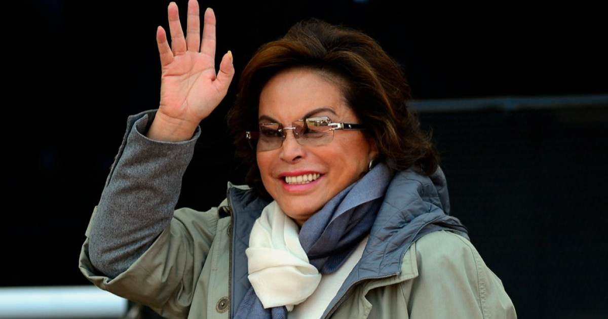 Elba Esther Gordillo waves during the National Police Day ceremony in Mexico City, on June 2, 2012. Gordillo was arrested Feb. 26 on allegations of embezzling union funds for personal use.</p>