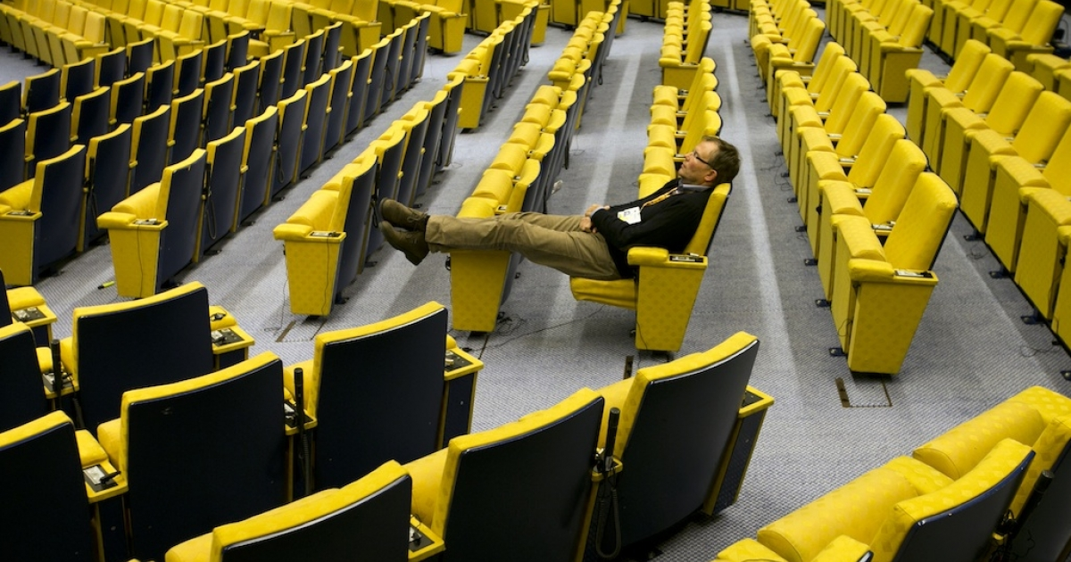 A man sleeps in the main hall at the headquarters of the Council of the European Union on February 8, 2013 in Brussels, Belgium. A new report by Der Spiegel says that the US spied on the European Council building, as well as EU diplomats in the United States.</p>