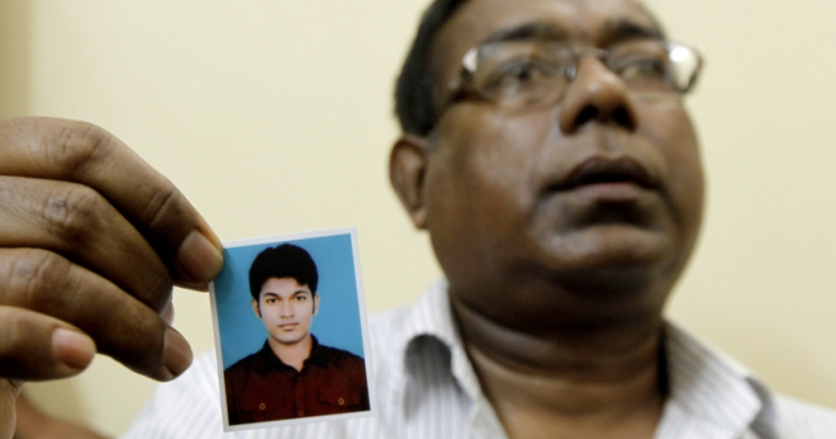 The father of Bangladeshi national Quazi Mohammad Rezwanul Ahsan Nafis arrested in New York for attempting to detonate a bomb, holds a portrait of his son in Dhaka on October 18, 2012.</p>