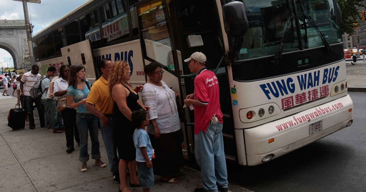 Passengers prepare to load a Fung Wah bus before leaving Manhattan for Boston August 4, 2008 in New York City.</p>