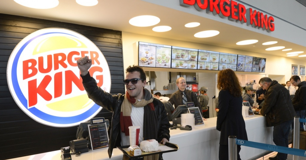 A customer reacts after being served at the Burger King fast food restaurant in Marseille's airport, in Marignane, southern France, on Dec. 22, 2012. Marignane's Burger King is the first shop of the brand to open in France after 15 years of absence and marks the return of the famous Whopper burger in the country.</p>