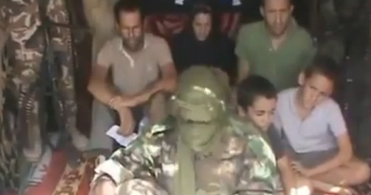 The Moulin-Fournier family in captivity, as shown in a video released by Boko Haram in February.</p>