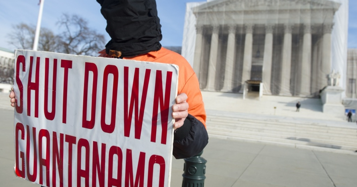 A protester dresses like a Guantanamo Bay prisoner during protests against holding detainees at the US military prison in front of the Supreme Court in Washington, DC, on Jan. 8, 2013.</p>