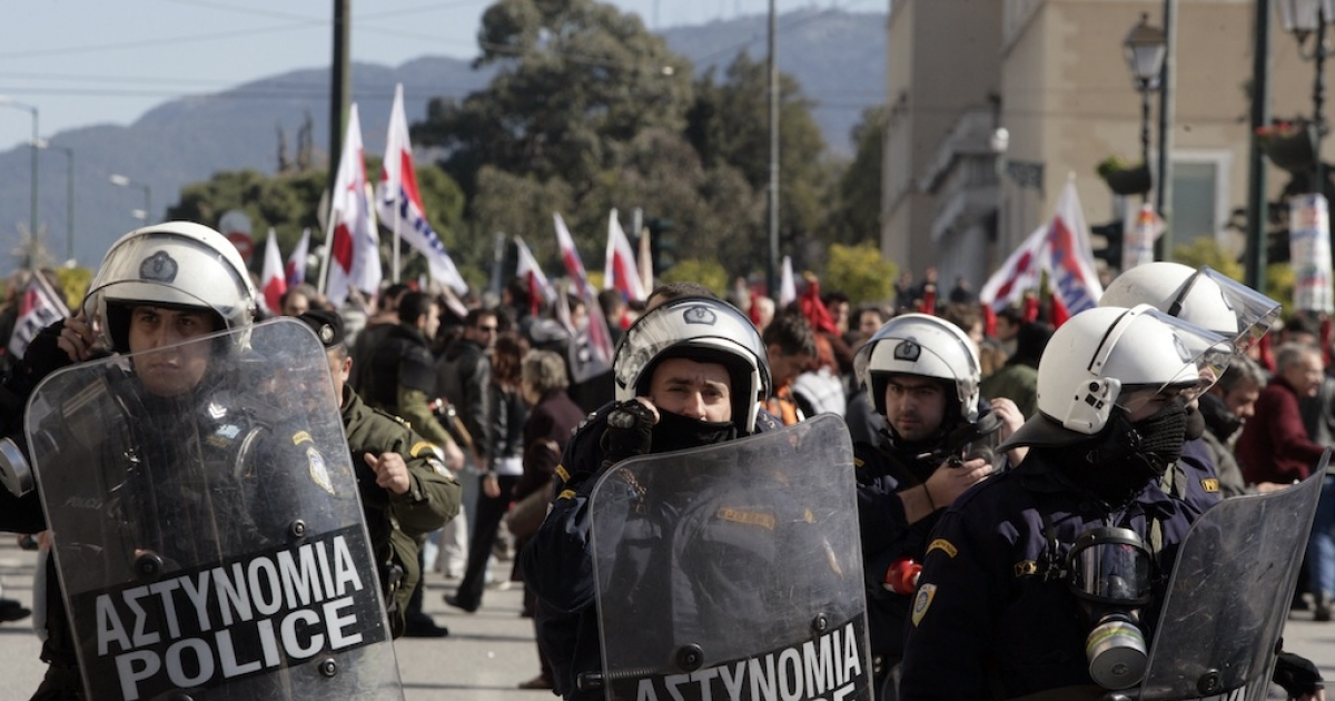 Riot police outside Greece's parliament during a protest on Feb. 20, 2013 in Athens.</p>
