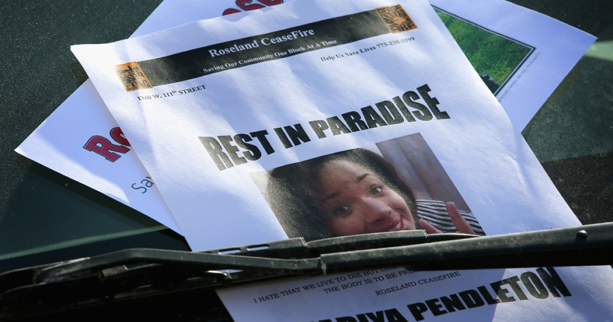 A flyer which asks for help in finding the killer of 15-year-old Hadiya Pendleton is left on a car near Harsh Park on Feb. 1, 2013, in Chicago.</p>