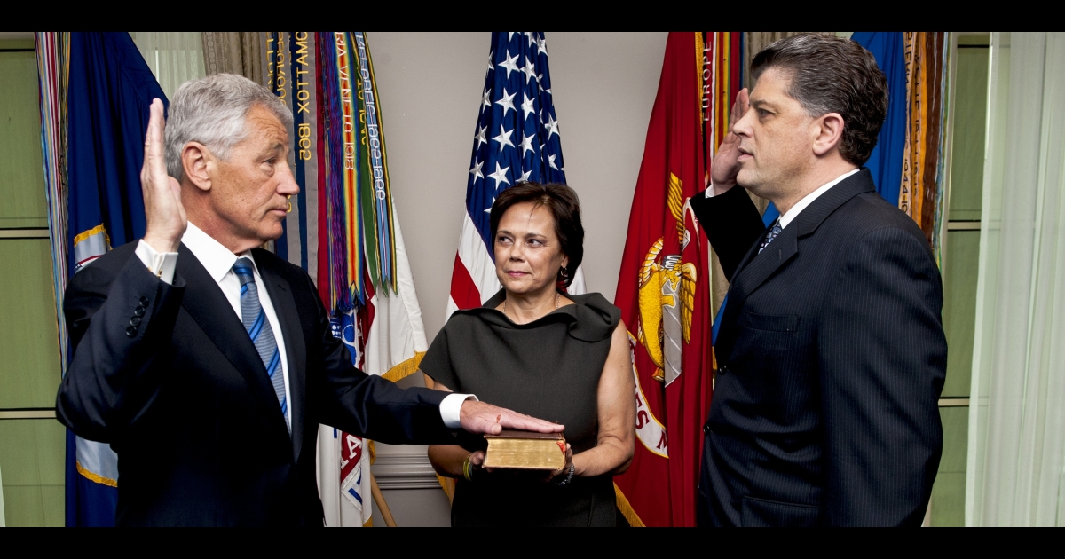 As his wife Lilibet holds the bible, Chuck Hagel is sworn into office as the 24th secretary of defense at the Pentagon on Feb. 27.</p>