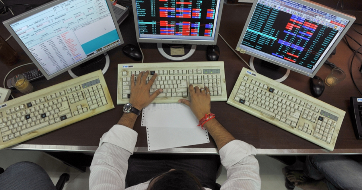 A stockbroker monitors share prices during trade at a brokerage house in Mumbai on Aug. 8, 2011.</p>