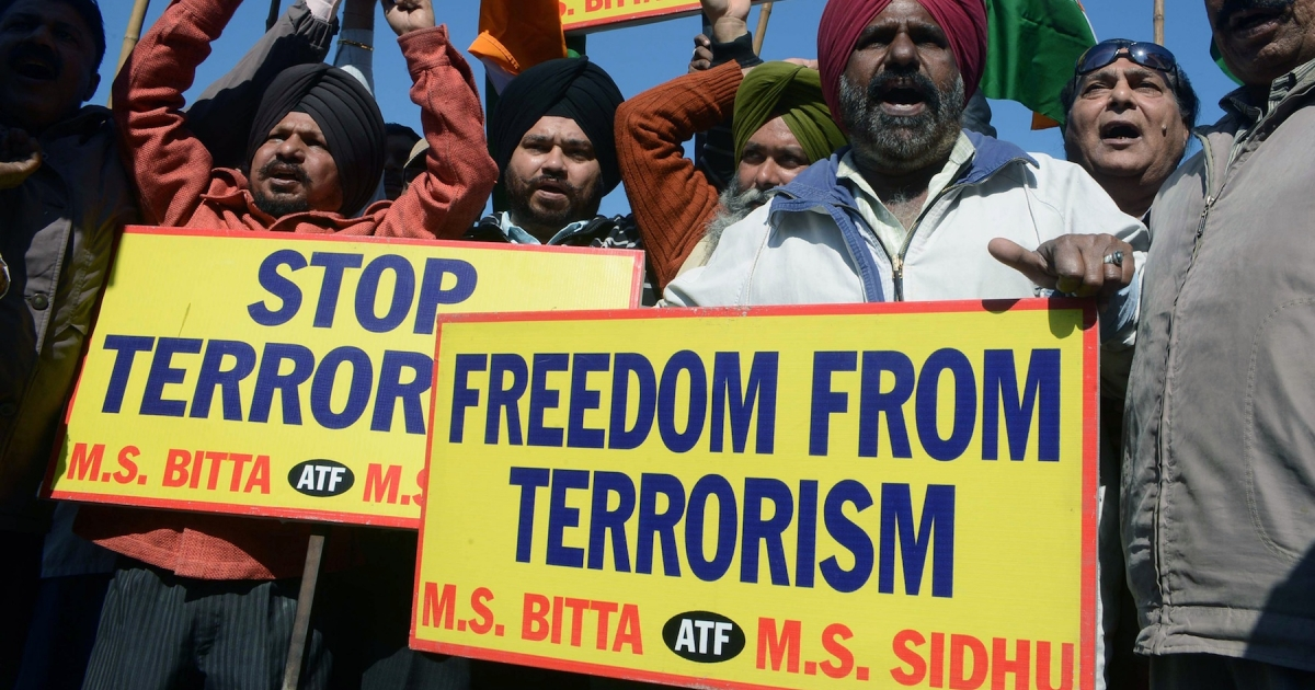 All India Anti Terrorist Front (AIATF) activists shout slogans as they celebrate the execution of Mohammed Afzal Guru, in Amritsar on February 9, 2013. A Kashmiri separatist was executed Saturday over his role in a deadly attack on parliament in New Delhi in 2001, an episode that brought nuclear-armed India and Pakistan to the brink of war.</p>