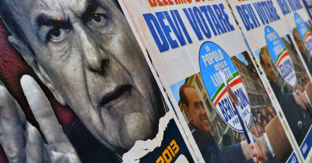 Italian electoral placards showing political rivals Pier Luigi Bersani, left, and Silvio Berlusconi. The sworn enemies may end up sharing control of the country.</p>