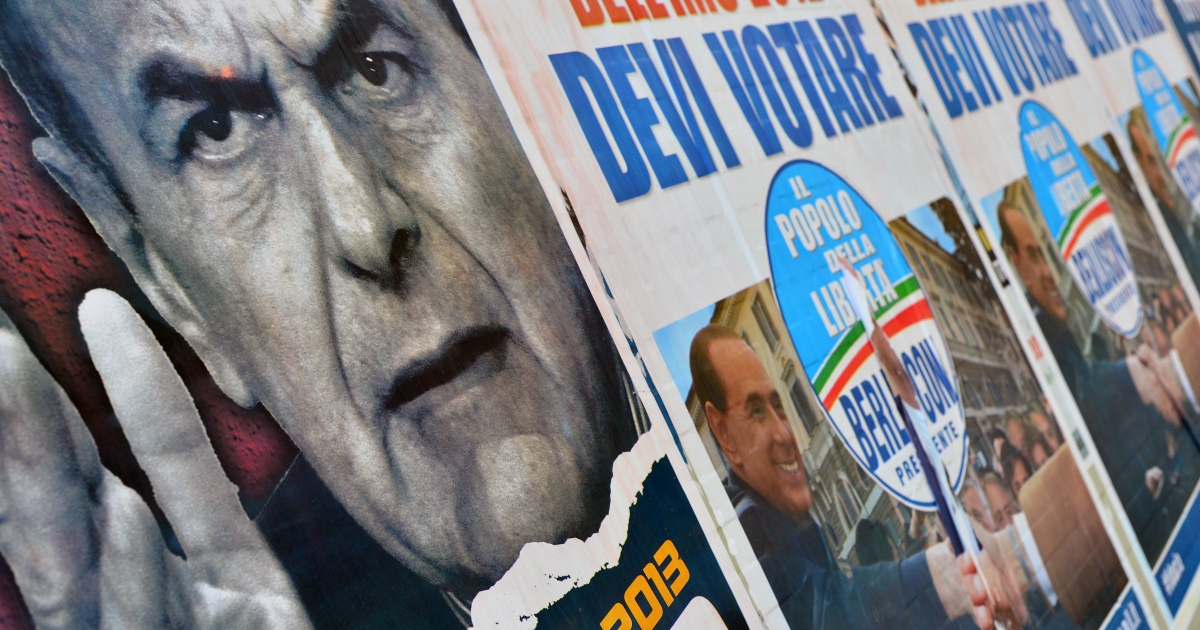 Election posters in Rome showing Democratic Party leader Pier Luigi Bersani (L) and right-wing Silvio Berlusconi. Italy is at an impasse after elections failed to produce a clear winner.</p>