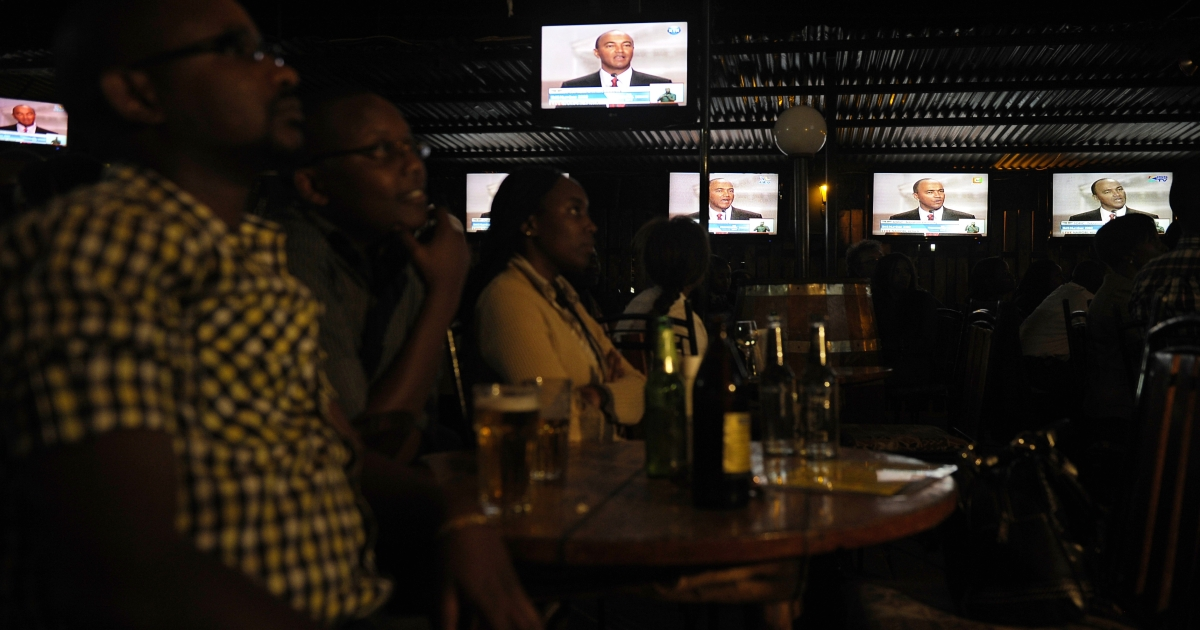 Kenyans in Nairobi watch the country's first-ever presidential debate on Feb. 11, 2013.</p>