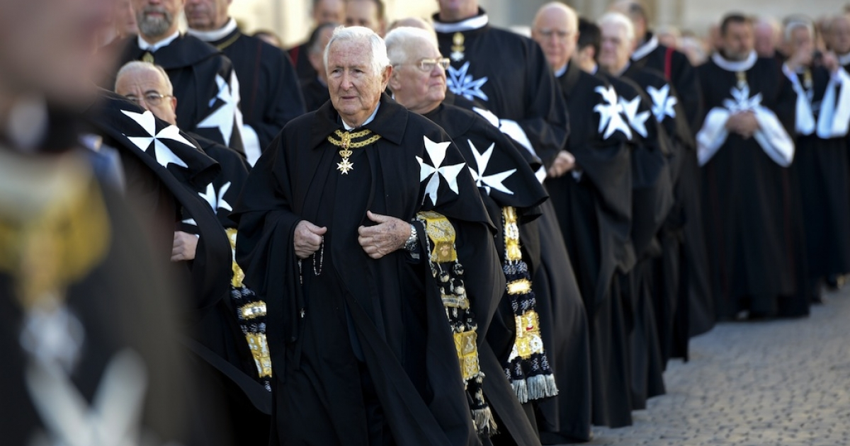 Knights of the Order of Malta walk in procession towards St.Peter's Basilica to mark the 900th anniversary of the Order of the Knights of Malta, on February 9, 2013 at the Vatican.</p>