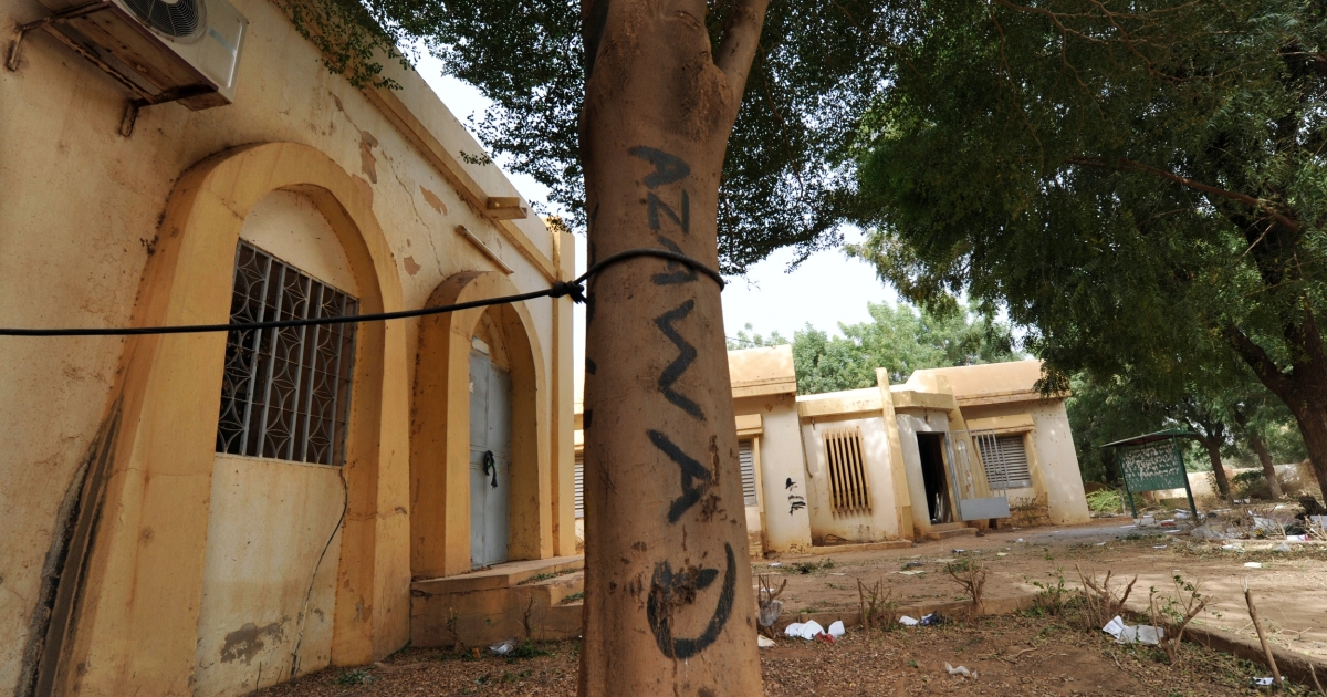 The name of the National Movement for the Liberation of Azawad (MNLA) written on a tree in front of the town hall in Gao, Mali, on Feb. 1, 2013.</p>