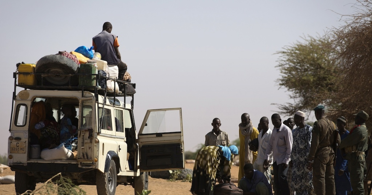 Malian people are controlled by Malian soldiers at a check point on February 23, 2013 in the center of northern Mali's largest city of Gao. Fresh fighting erupted in northern Mali, security sources told, the latest unrest to hit the area in the wake of a French-led campaign that drove radical Islamist fighters from major cities.</p>